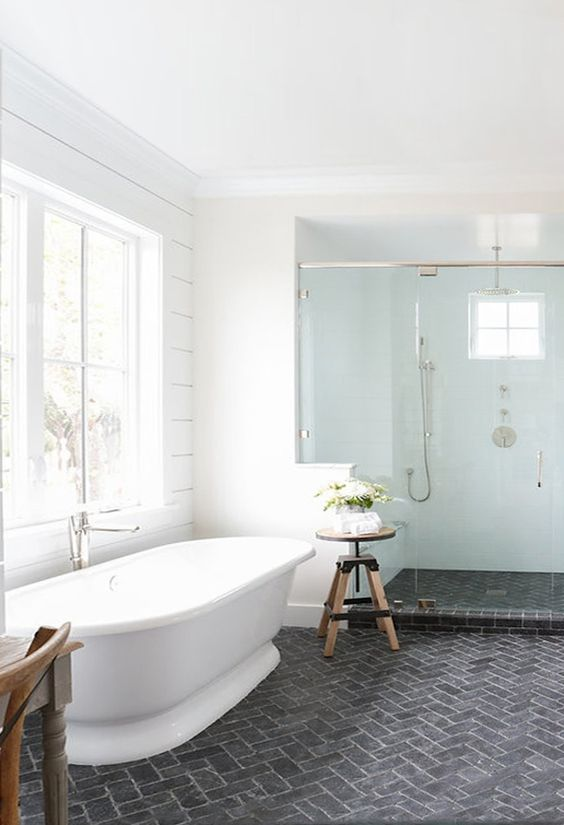 modern white bathroom with slate brick floors