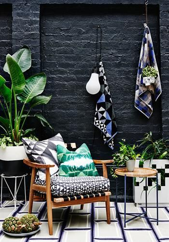 small backyard with black brick wall