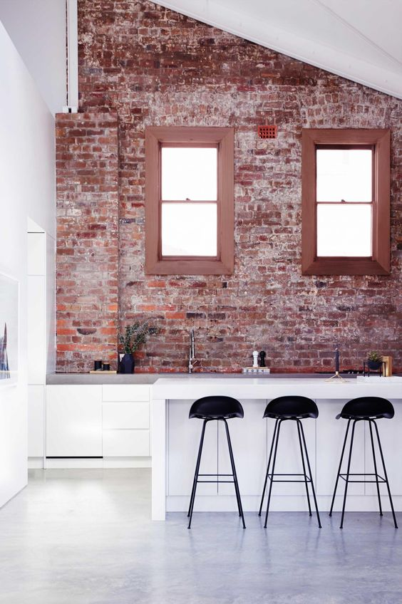 contemporary kitchen with rough brick wall