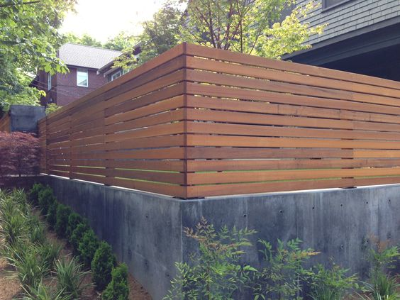 wood and concrete fence