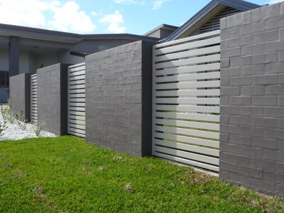 brick and metal fence