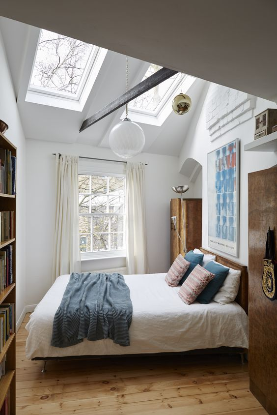 small bedroom with skylights