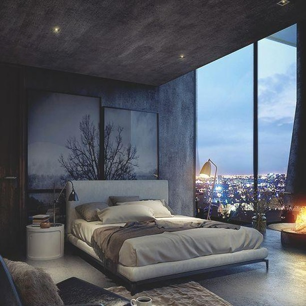 Utilise your view! This strong, dark and brilliantly designed bedroom is the perfect example of #goals  #RenoGuide #Bedroom #BedroomGoals #BedroomInspo #DesignInspo #InteriorDesign #Dark #CityViews