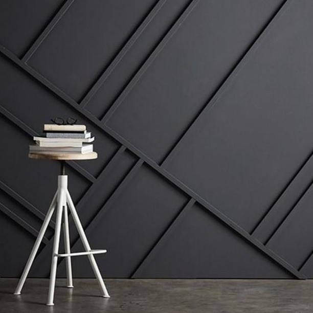 Turn a boring blank wall into a unique and fascinating home feature by adding an eye-catching woos strip patterns. This otherwise sombre black wall is made exceptional by the addition of randomly slanted wood strips.  #RenoGuide #DIY #InteriorDesign #Black #FeatureWall #DesignInspo #Inspo #Minimalist