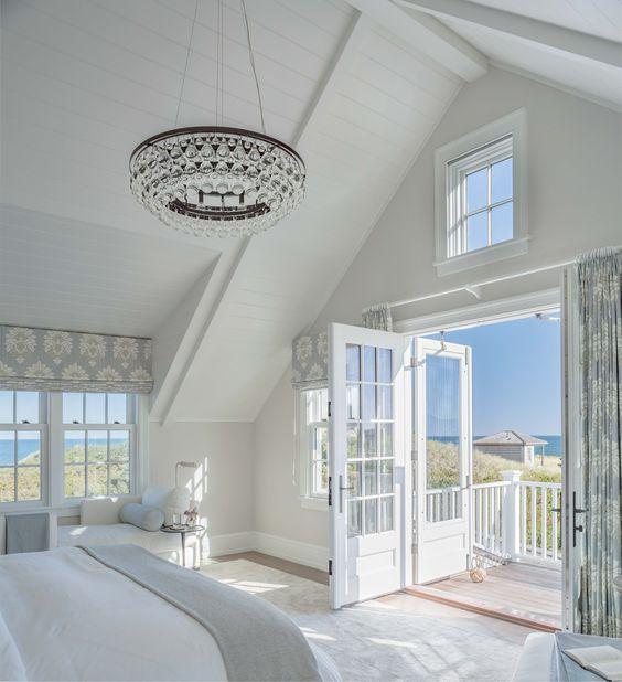 white bedroom with balcony