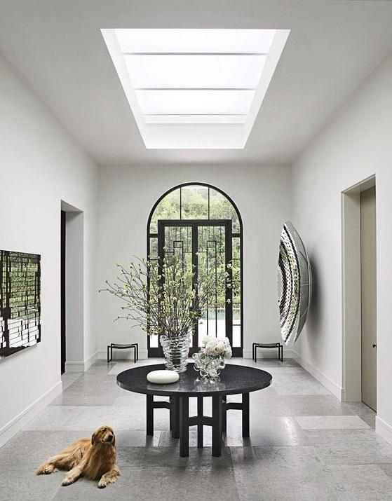 elegant foyer with skylights