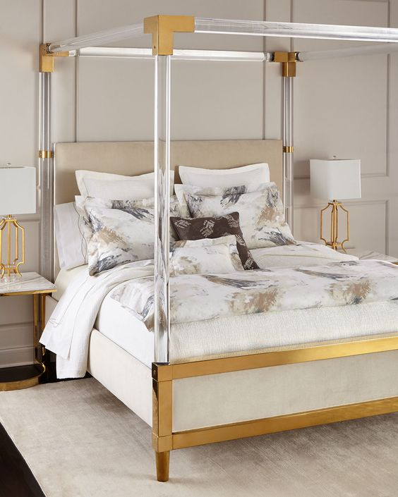glass and brass four poster bed