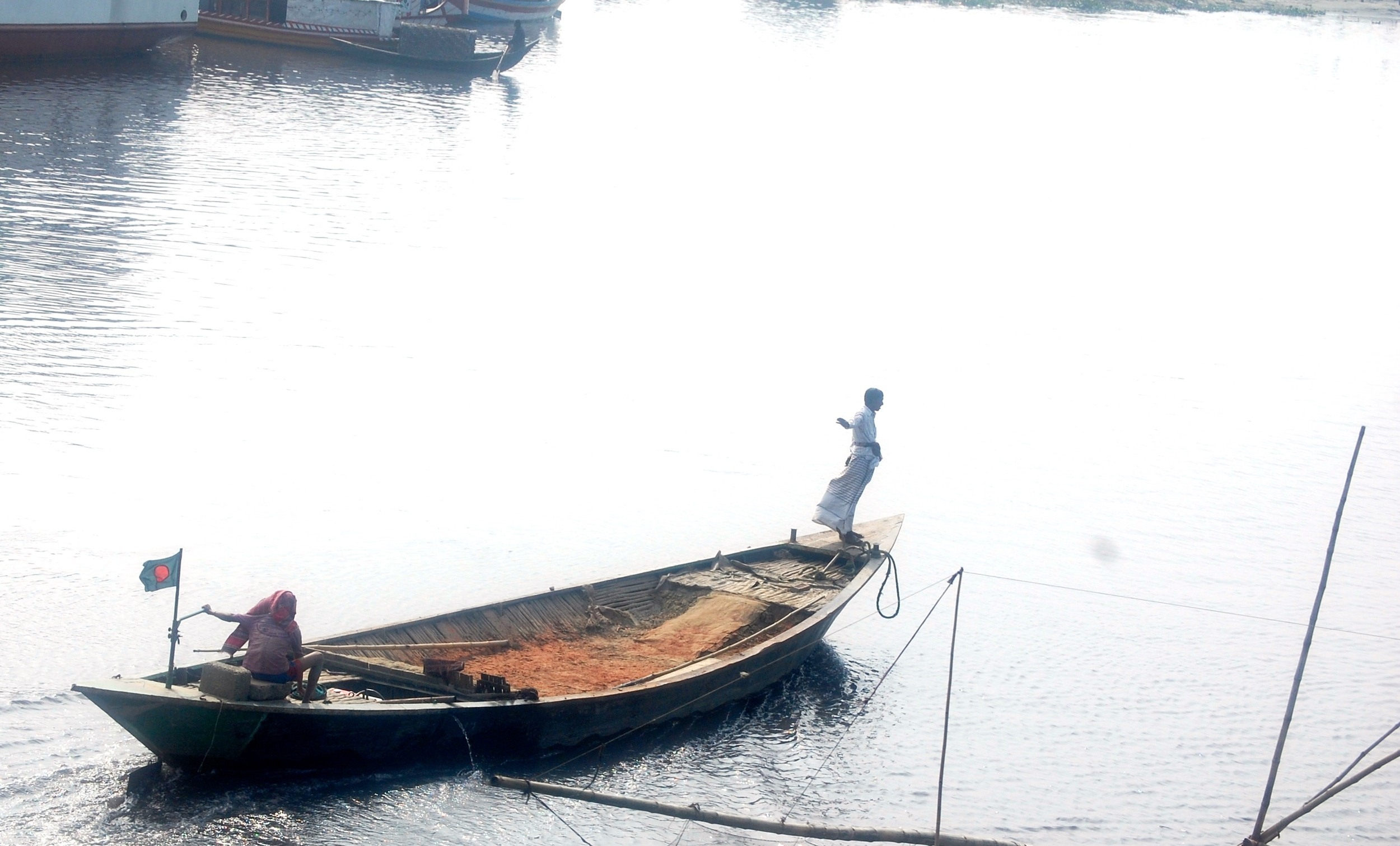 Men on boat outside Dhaka