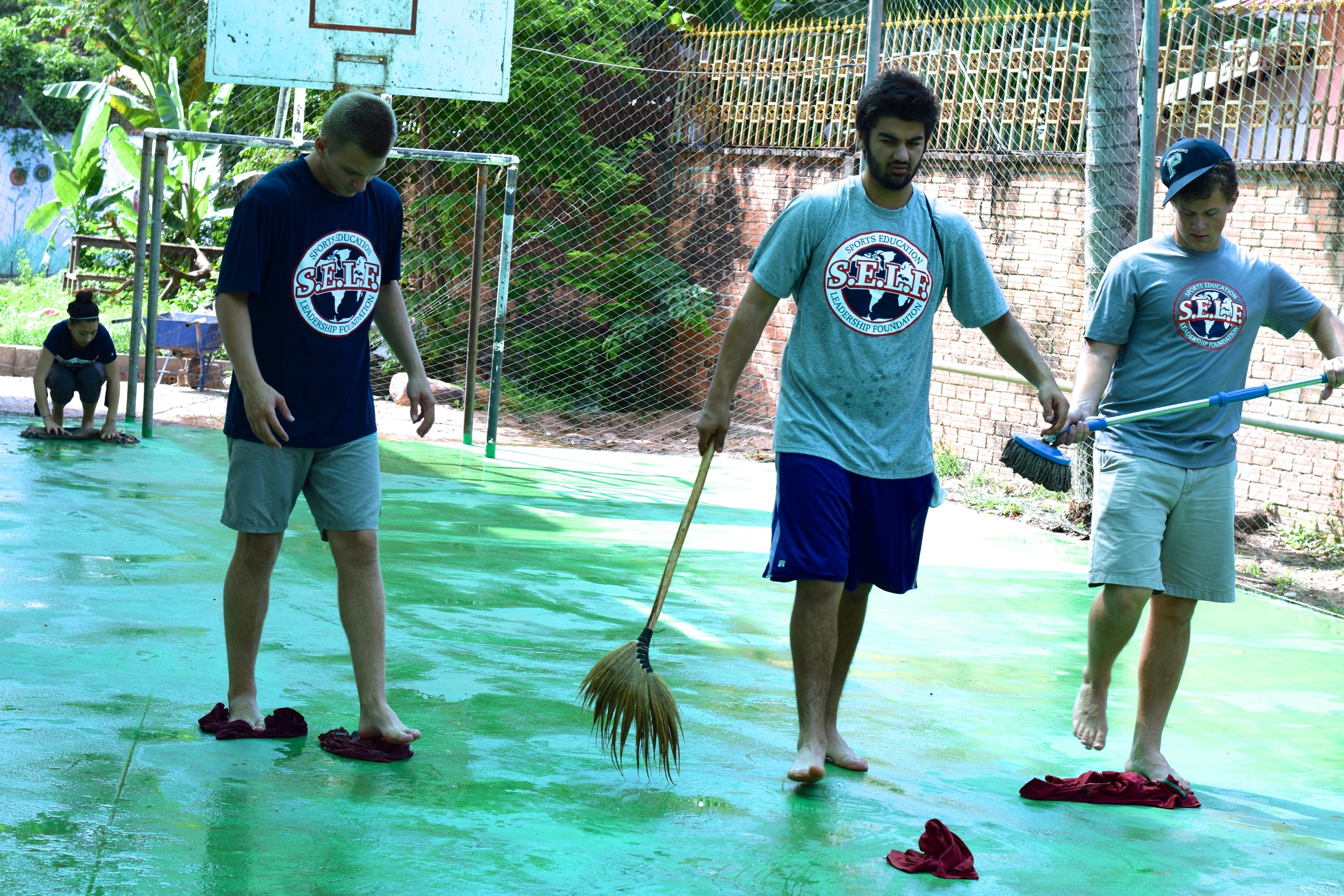 Hunter, Alisina and Matt cleaning the court