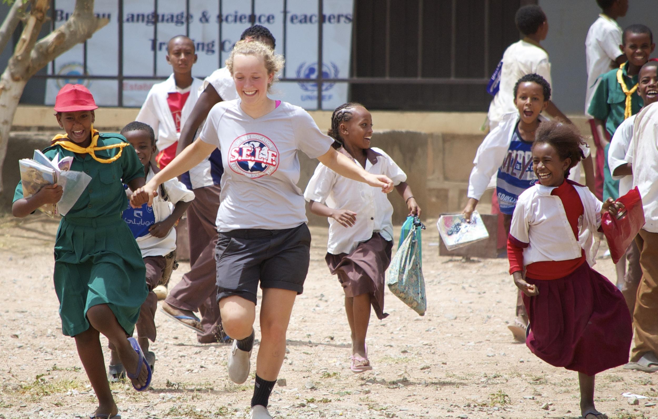 Children running with Lyric
