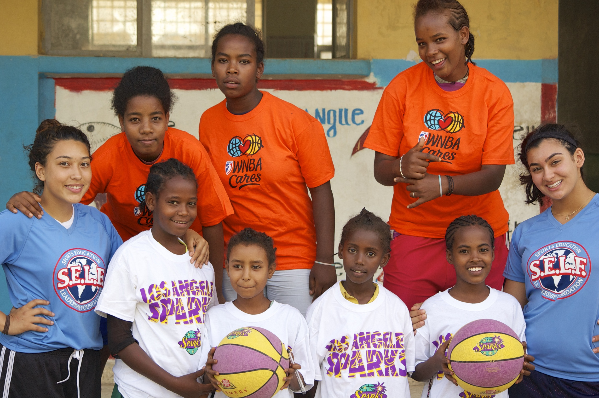 Wendy and Hanna with girls and their new WNBA Cares and Sparks t-shirts
