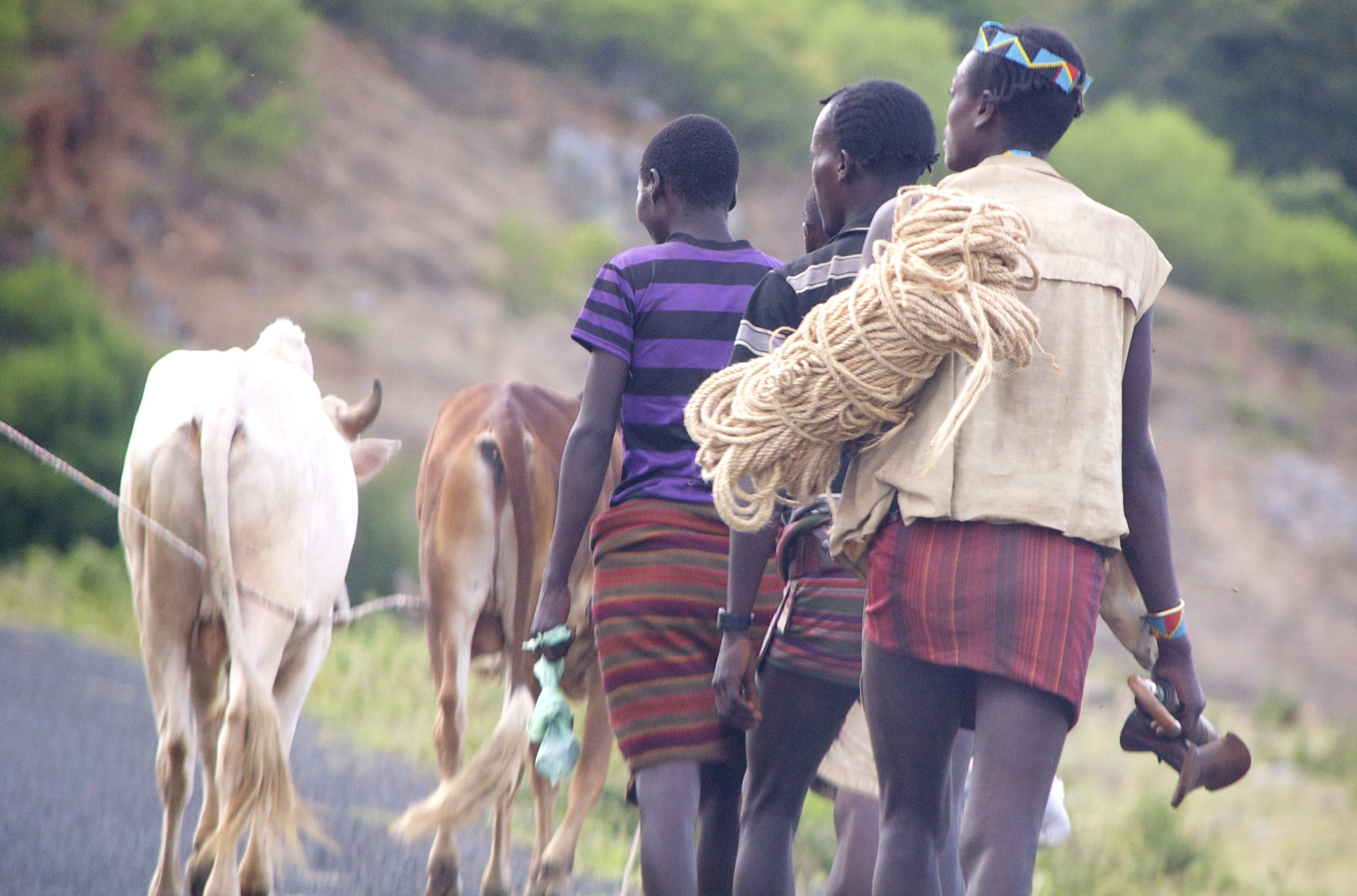 Tribe members walking from the market