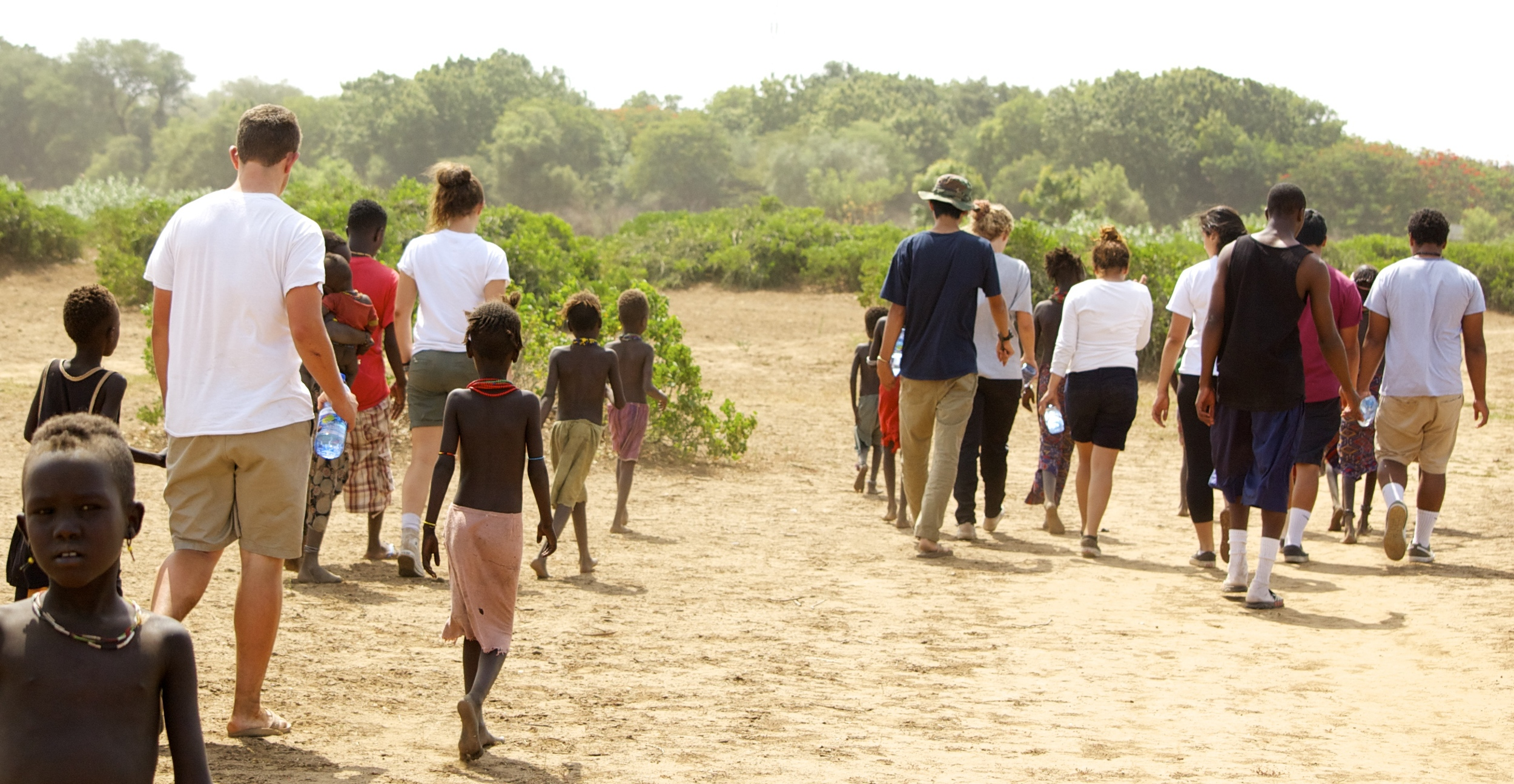 The children from the tribe walking us back to the river