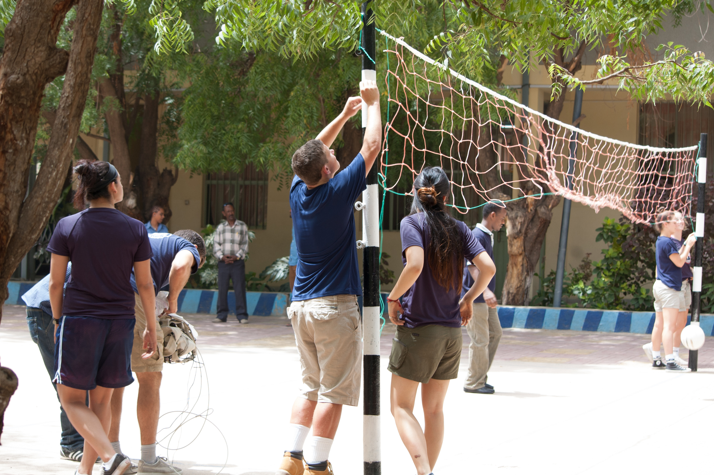 Putting up the new volleyball net