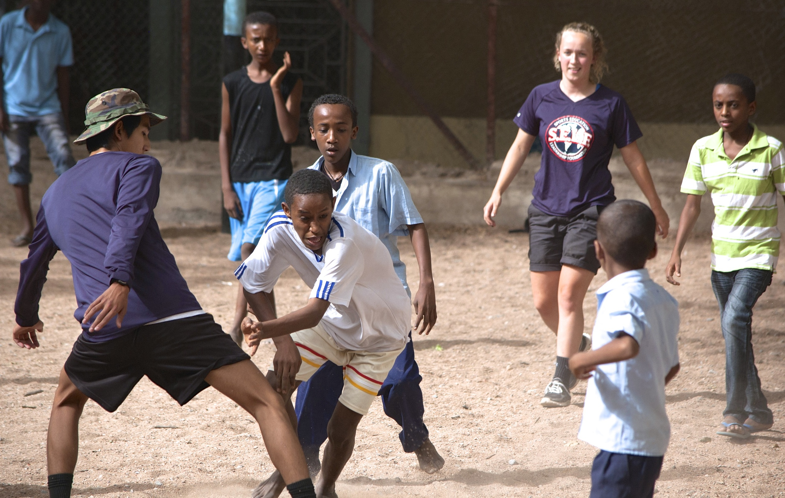Churl and Lyric playing soccer with their group