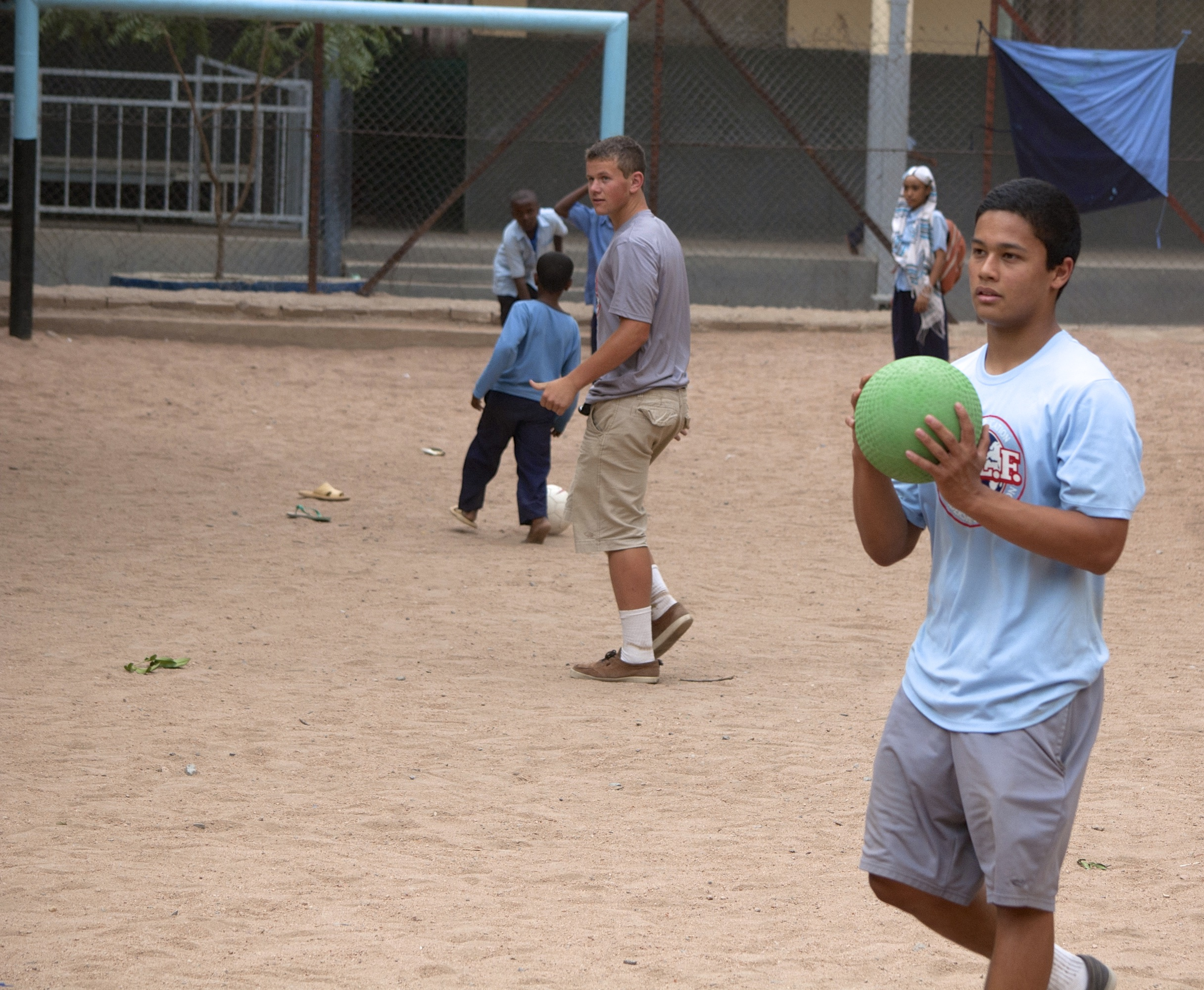 Joey pitches the ball in kickball