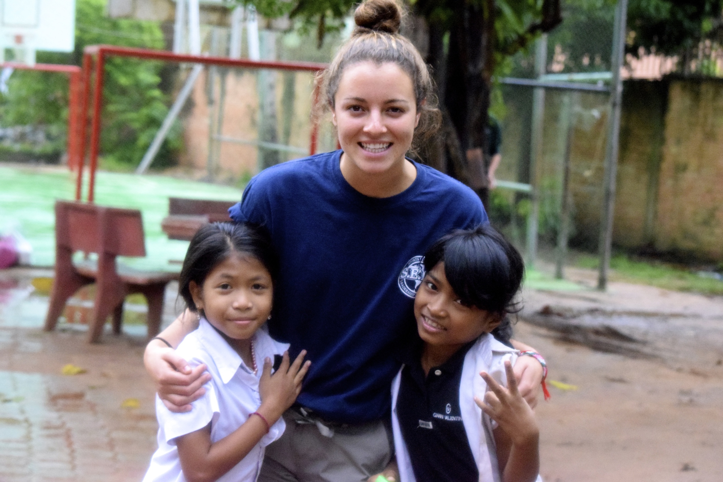 Hannah Wasserman, Vice President with two girls in Cambodia