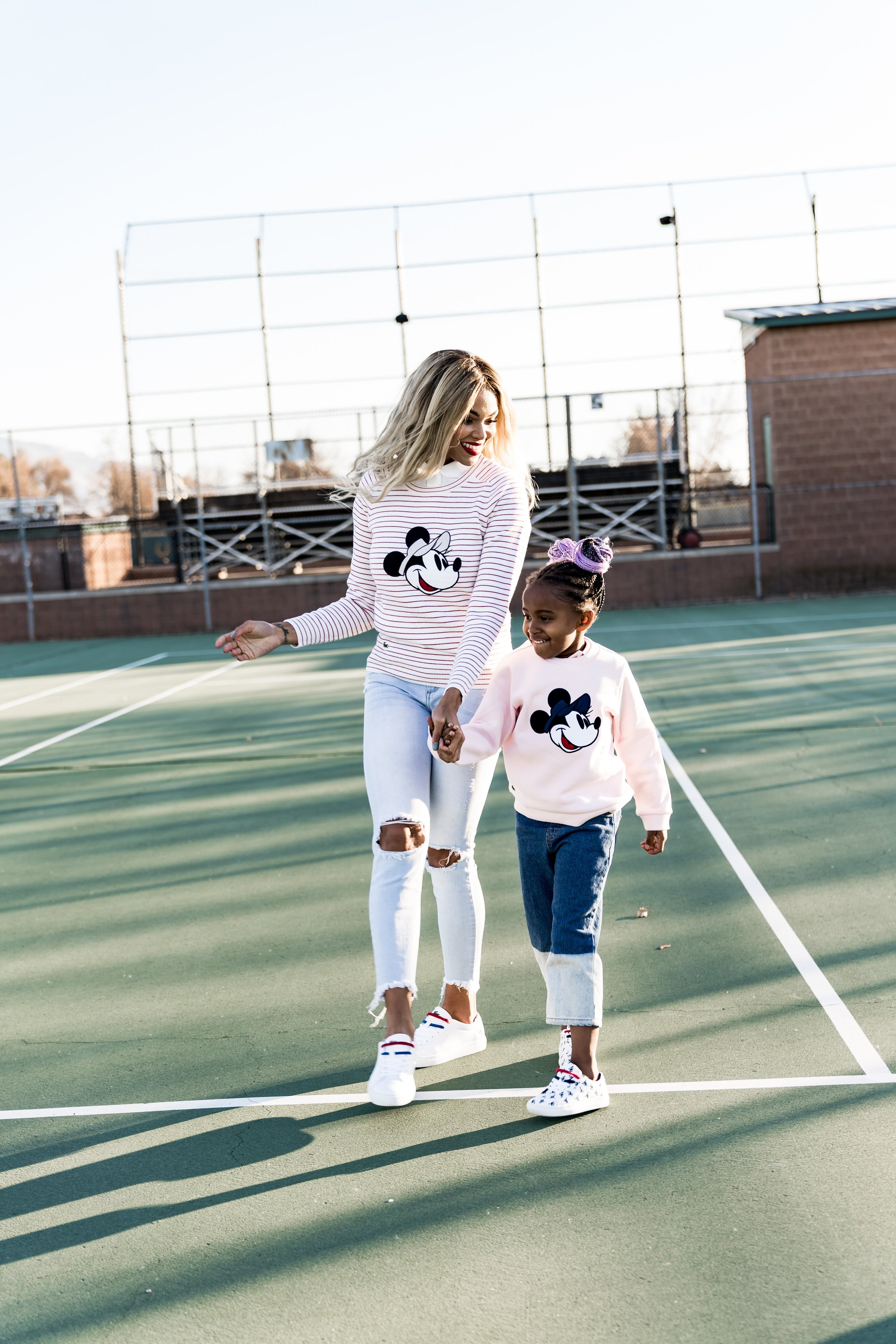 Top fashion blog, Mom Crush Monday, features the NEW Lacoste x Disney Collection perfect for your entire family: image of a family wearing the new Lacoste Disney collection