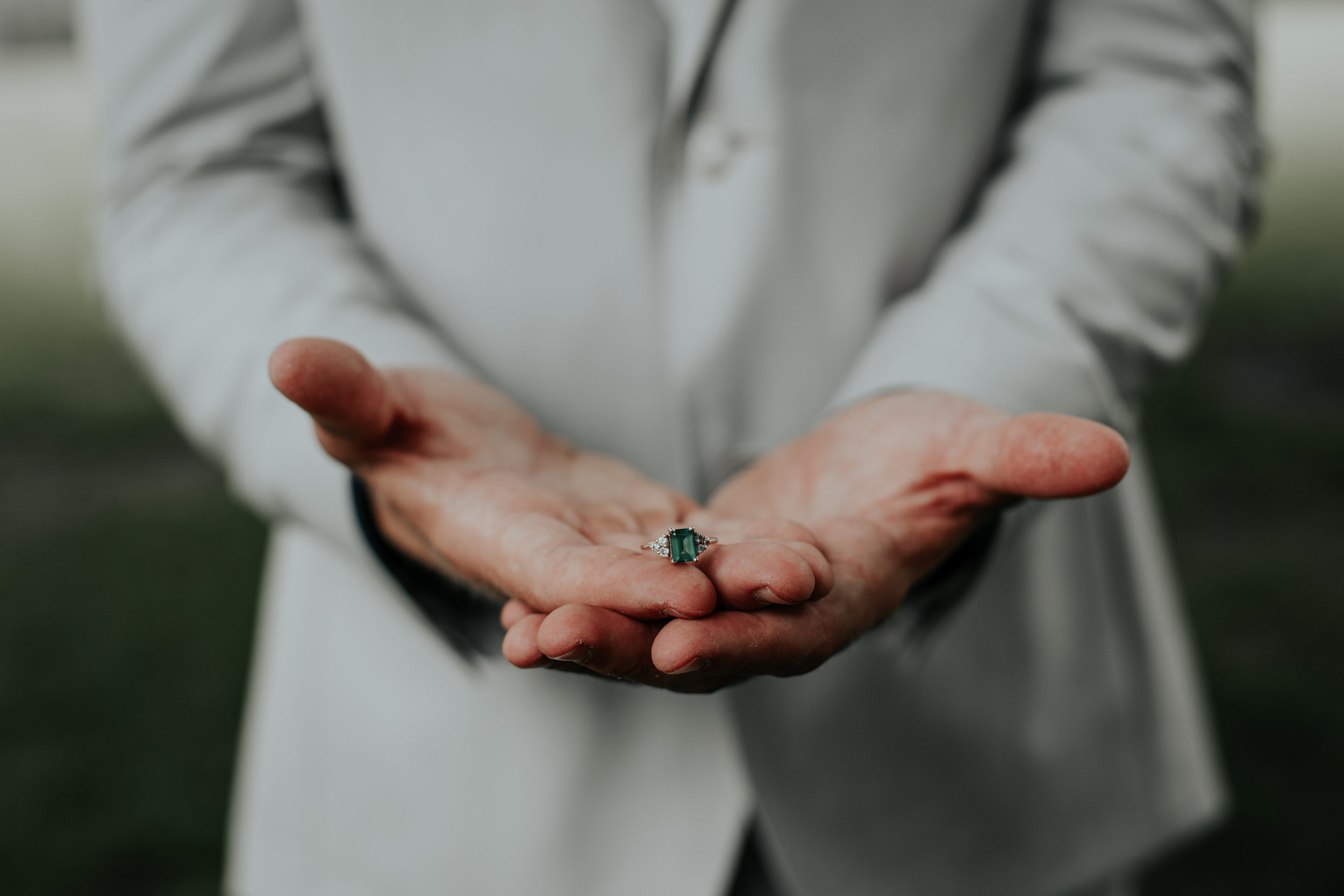 Groom holding rings | Be Images