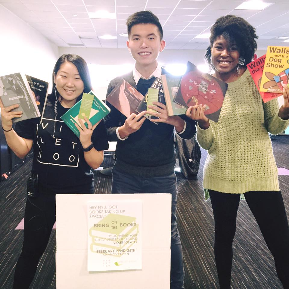 Jason at a book drive with Carolynn and McKenzie