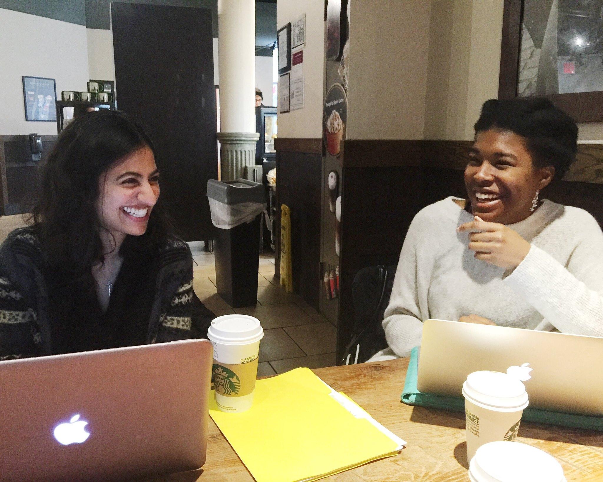 Hediya and McKenzie at a team meeting