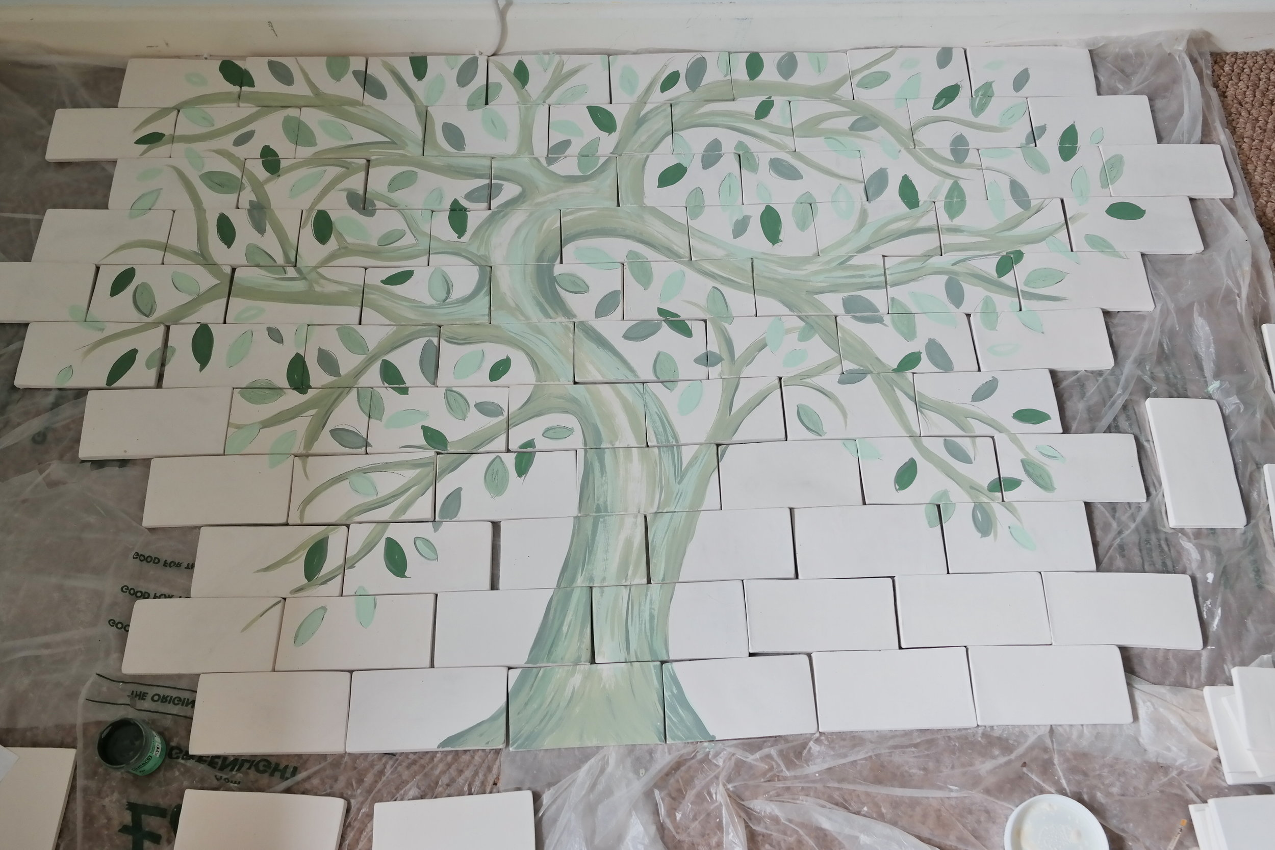 unfired tiles painted with underglaze