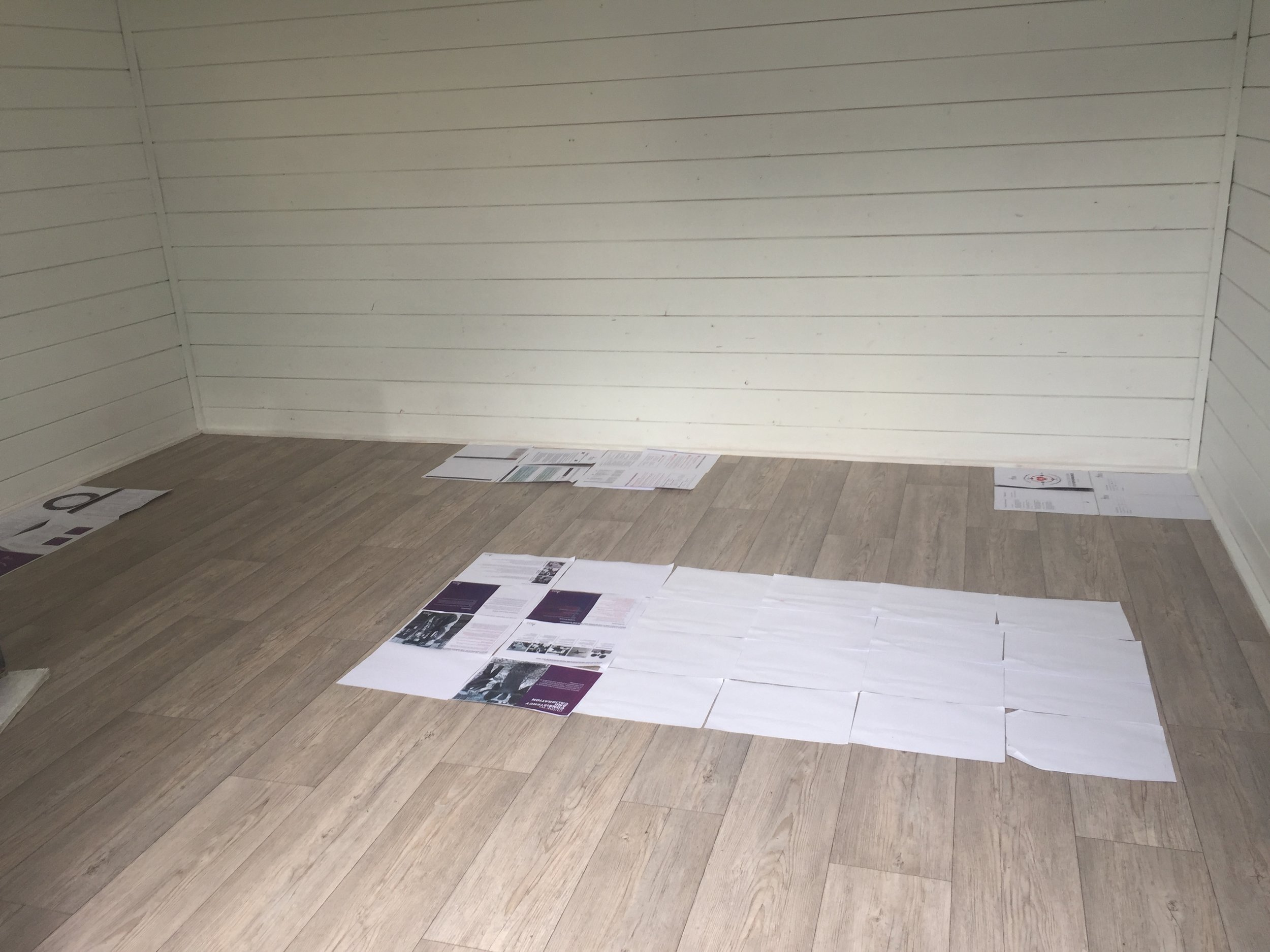 Planning the size and position of furniture by plotting out the space using paper.