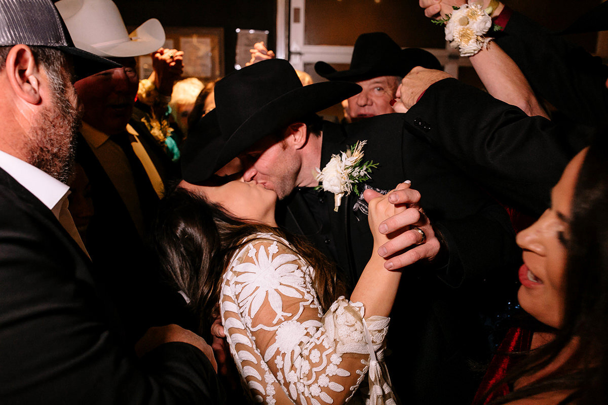 Lacey's family has a traditional wedding dance where they crowd around the newlyweds in and out after the line arch dance!
