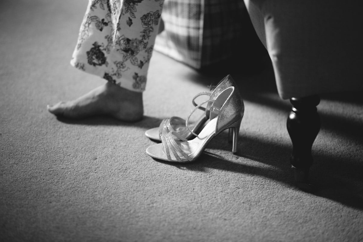 I love playing with the idea of building a narrative with a photograph, and also what it means to different people looking at it. To the bride it will provoke certain emotions of how she felt that day maybe even for just a split second whilst she was looking for her shoes, remembering how she was feeling maybe, relaxed, nervously excited, overwhelmed?