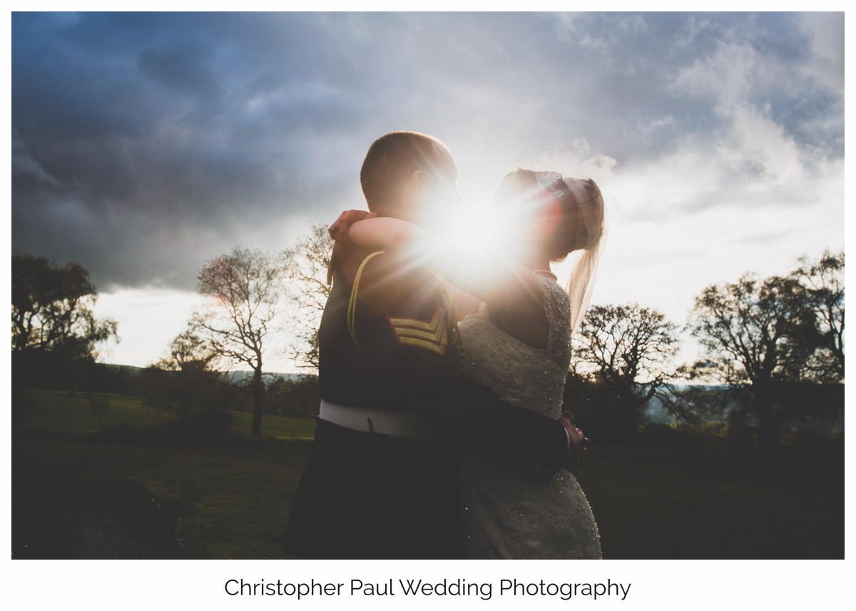 Bride and groom enjoying the Welsh sunset before their first wedding dance.