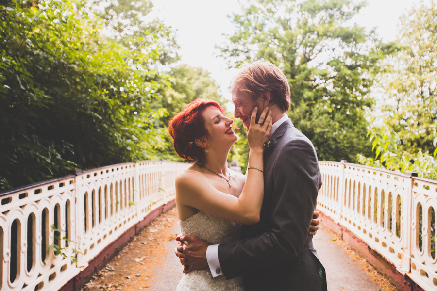 Bride and Groom enjoy a moment along outside the Elmgrove Centre in Bristol