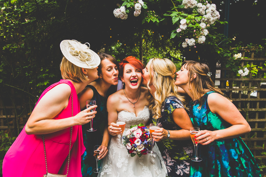The Bride and her Bridesmaids laughing and smiling outside the Elmgrove Centre in Bristol