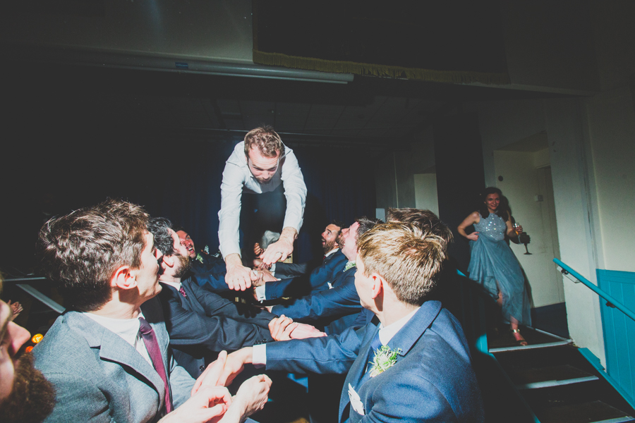 Standard stage dive from the groom at this alternative cornish wedding