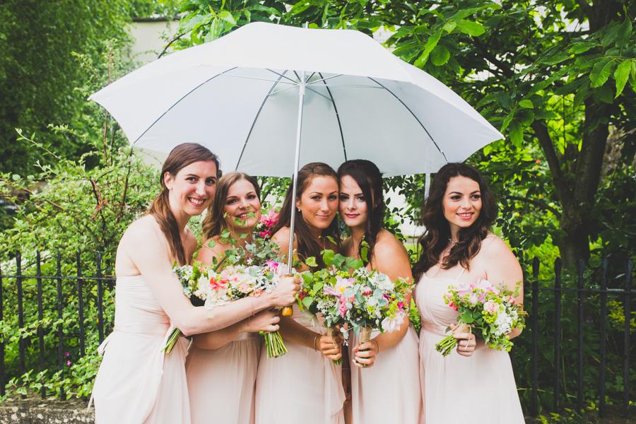 The Bridesmaids hide from the rain at Llanvihangel Court Wales