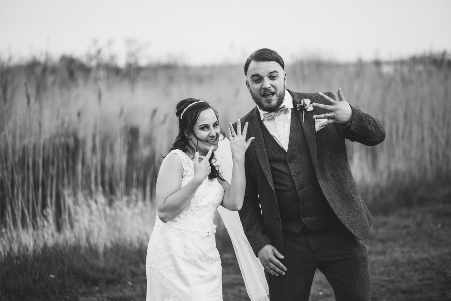 Goofing around as Mr and Mrs in Cardiff Bay wedding photography can be fun