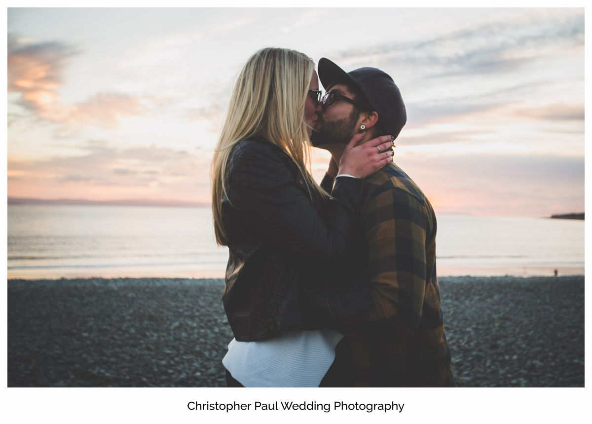 Chloe and Damien after talking about their big Canada Lake and Lodge wedding Cardiff Wedding Photographers