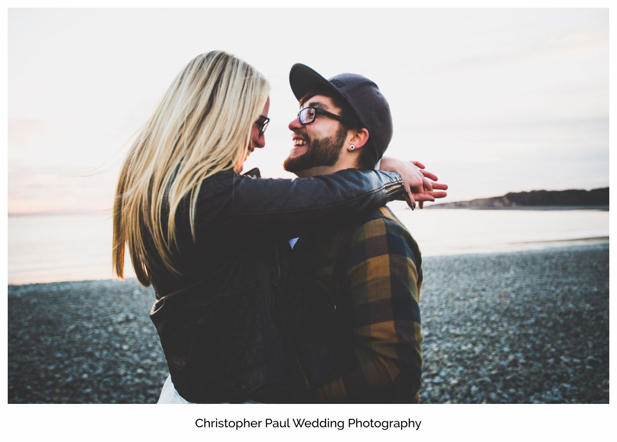 Chloe and Damien smiling and looking forward to their Canada Lake and Lodge wedding Cardiff Wedding Photographers