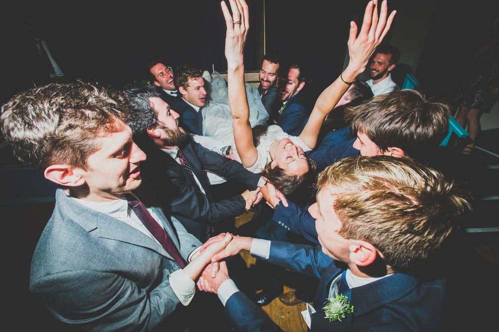 Rock and Roll Bride | She dives into the crowd at her wedding reception | Best Welsh wedding Photographers