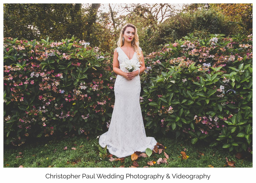 A beautiful wedding dress shot in the grounds at Bryngarw House a South Wales Wedding Venue