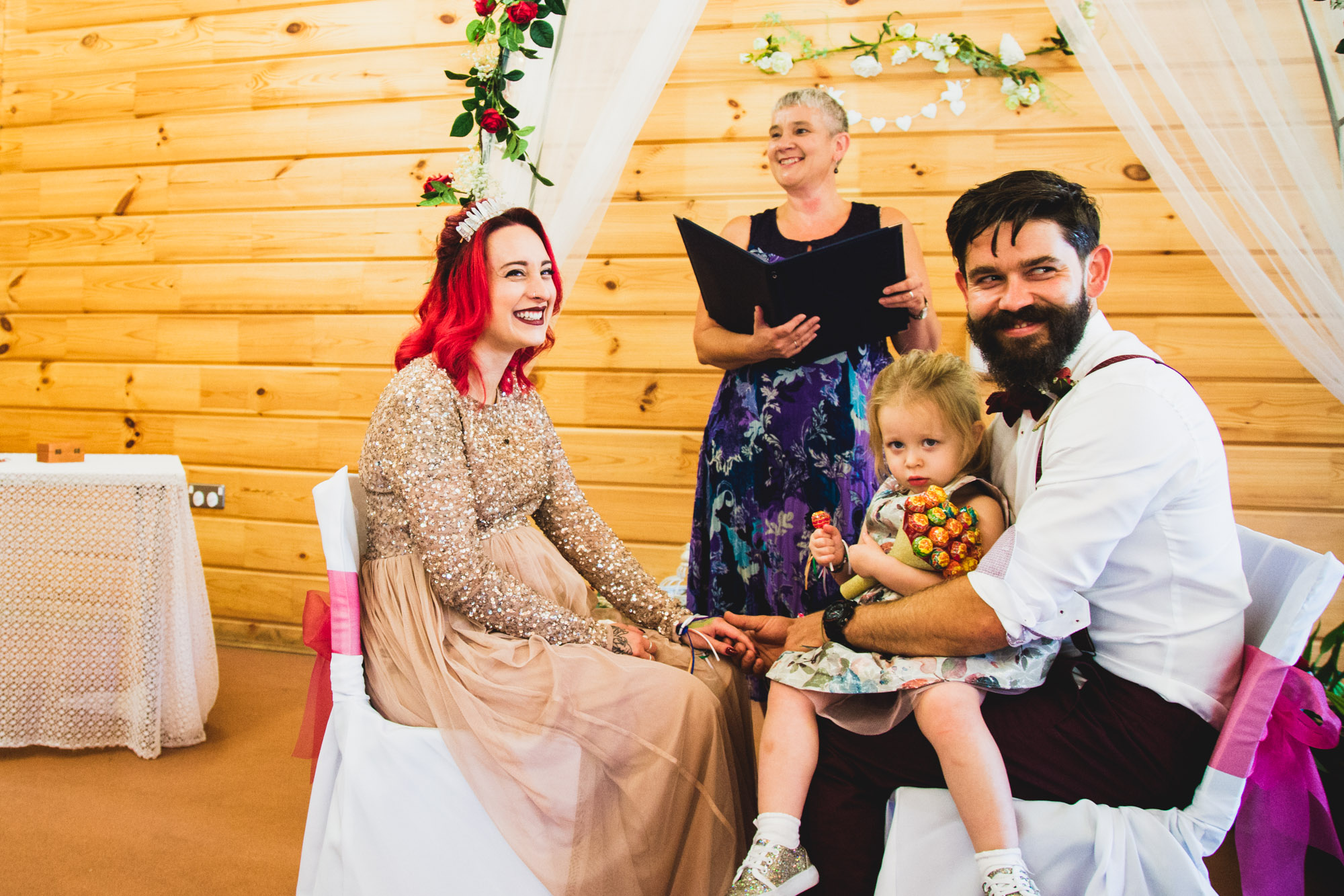 Bride and Groom with daughter at wedding ceremony