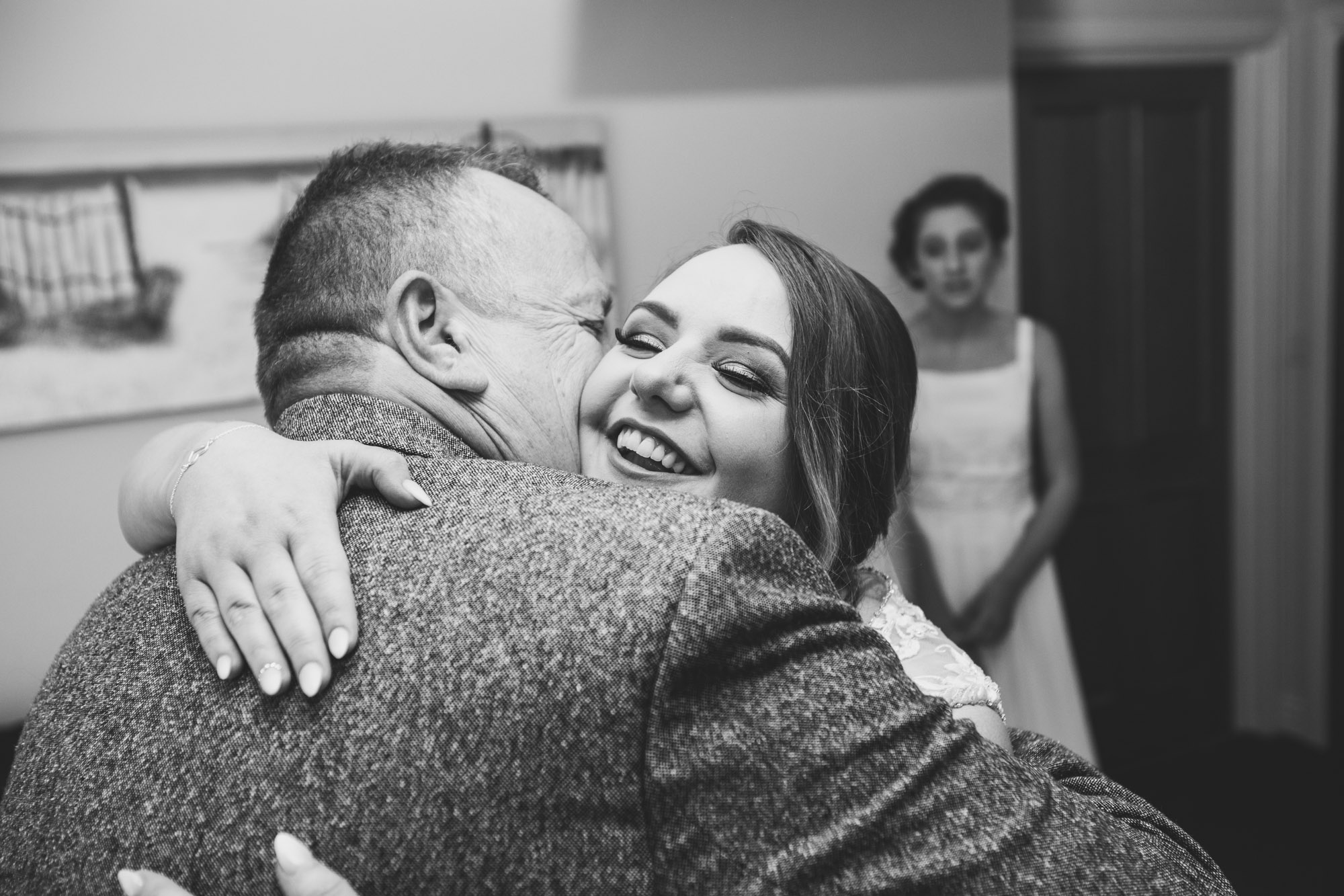 Bride and Father have a big cwtch