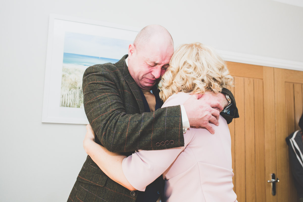 An emotional father of the Bride crying with joy
