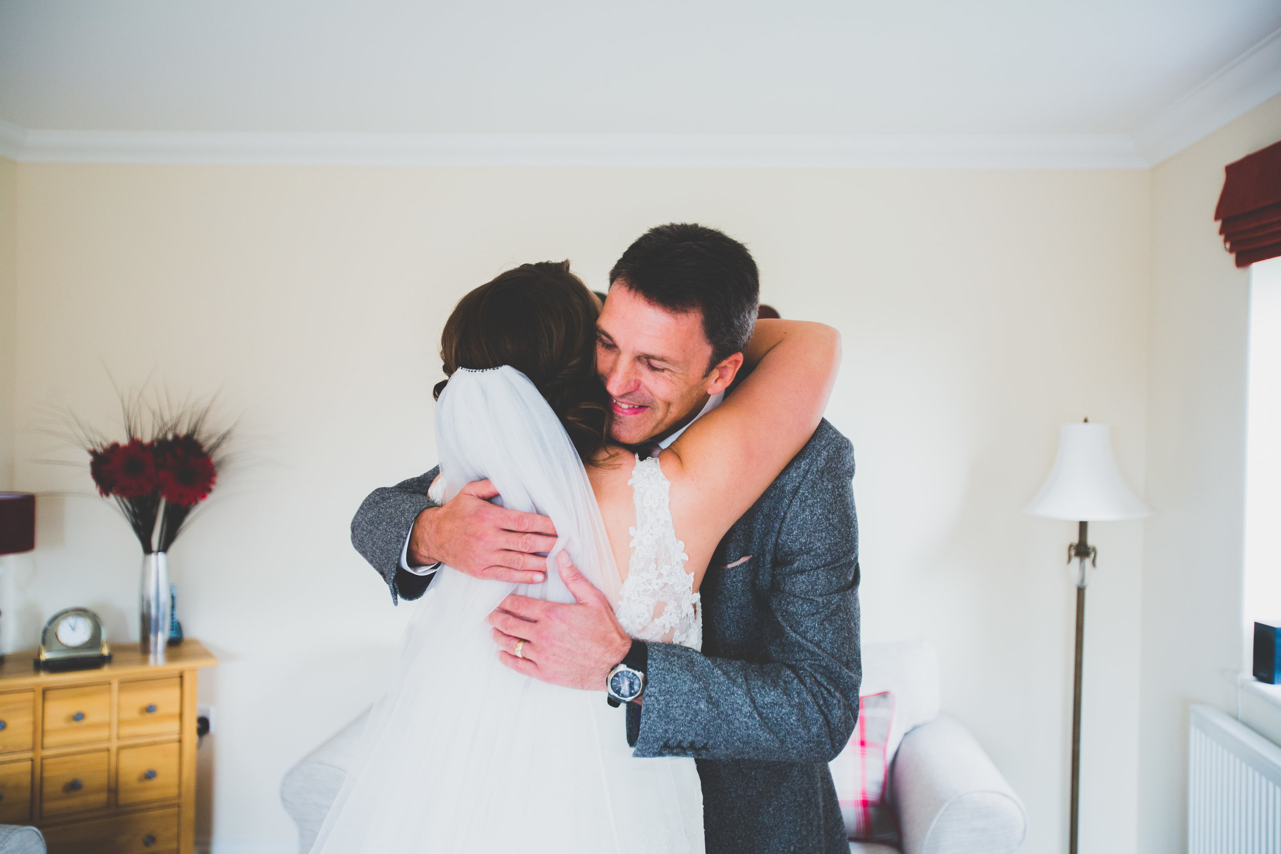 Bride and Her dad hug