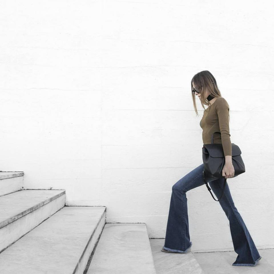 Nai Eli.  Fashion designer. Wearing model  Gorgoni Black Gr I  source Instagram