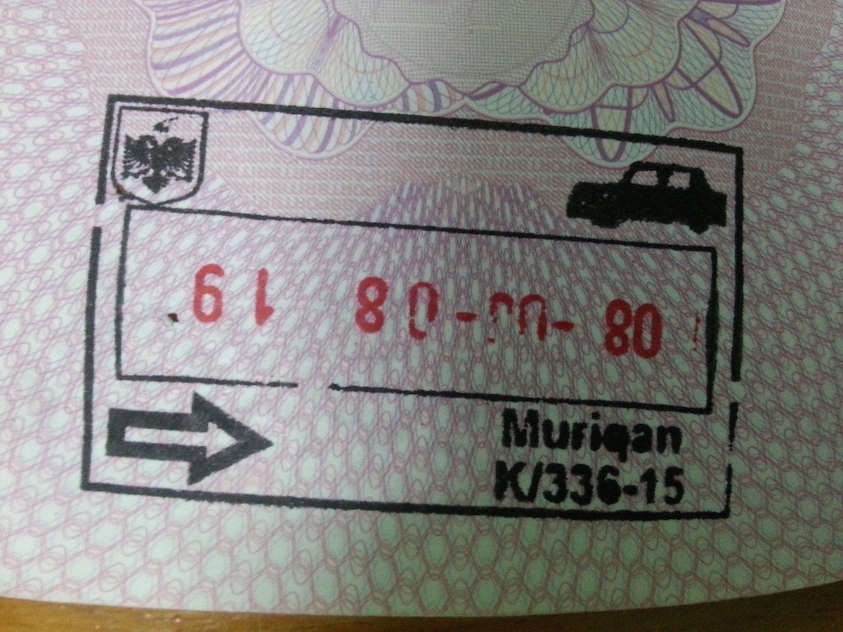 """Pic: Entry stamp at Muriqan, Albania. Albania is known as the """"Land of Eagles"""", hence the national insignia in the top left corner."""