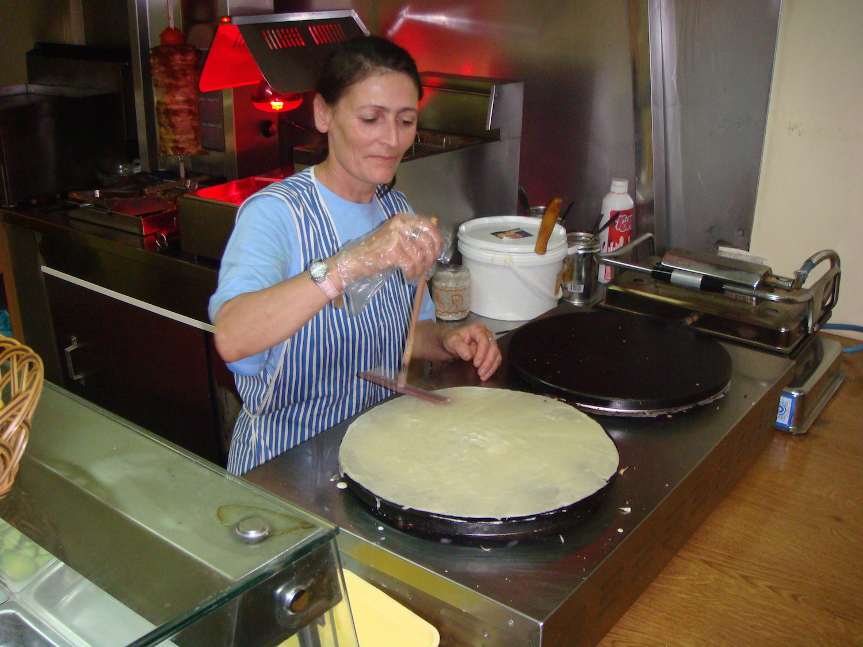 Pic: Woman preparing Albanian style kebabs in Vlorë