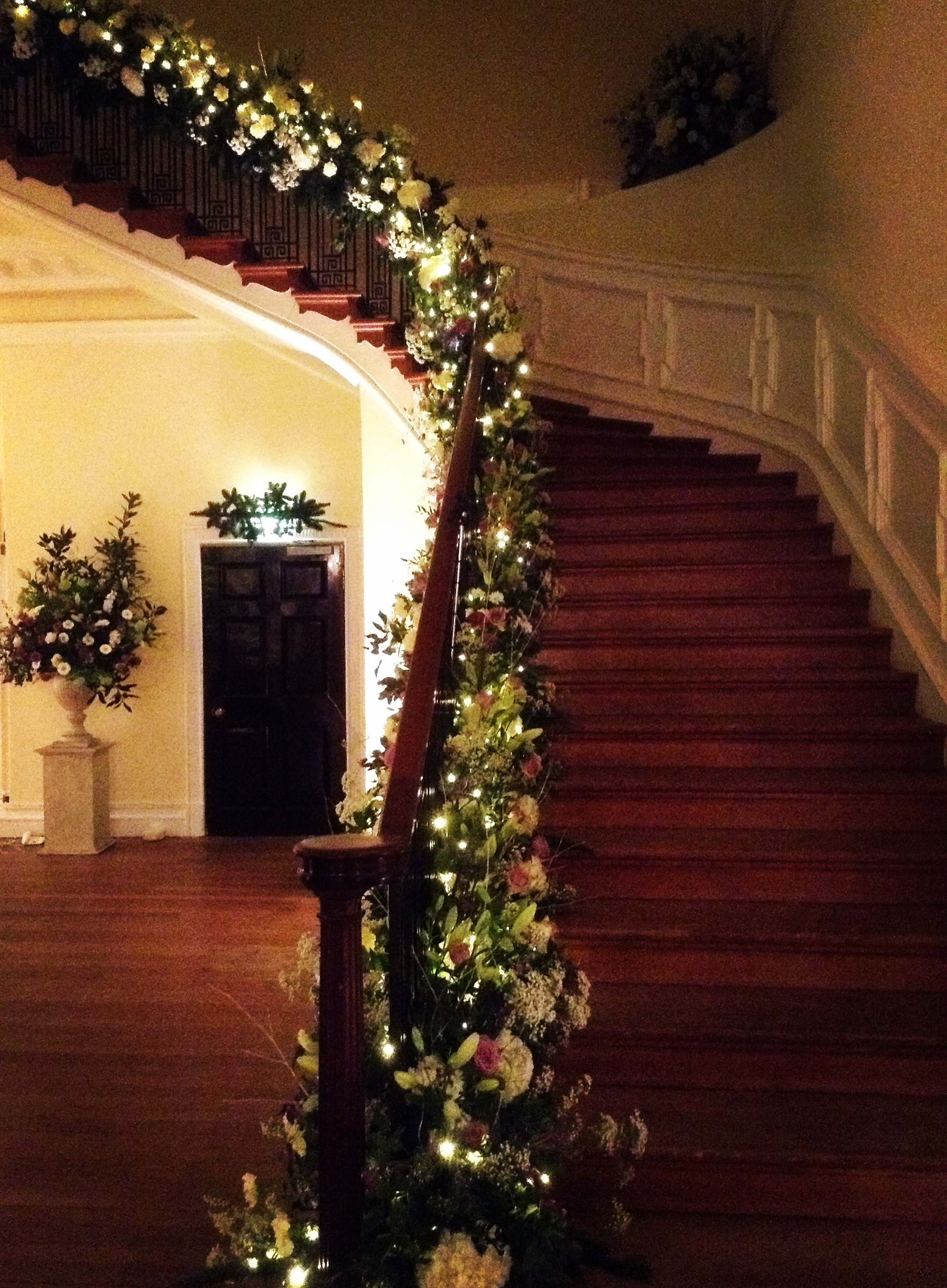 The staircase looking magical as evening comes. Executed by Paul Hervey-Brookes, Sue Robinson, Tracey Kennard and Andy McIndoe.