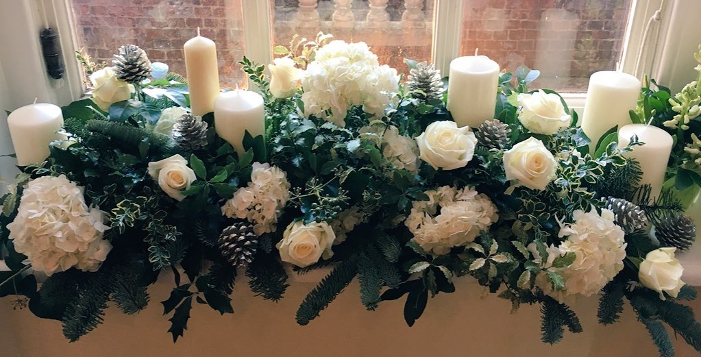 Cool greens and whites using Avalanche roses to create a lush sophisticated look on one of two complimentary window ledges done by me and Debbie Hicks.