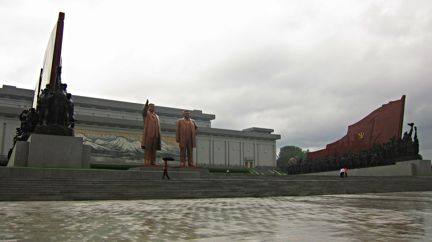 Pyongyang monuments to the Supreme Leader and the Dear Leader. We were only allowed to take pictures of the entirety of the bodies, not close-ups of the statues.