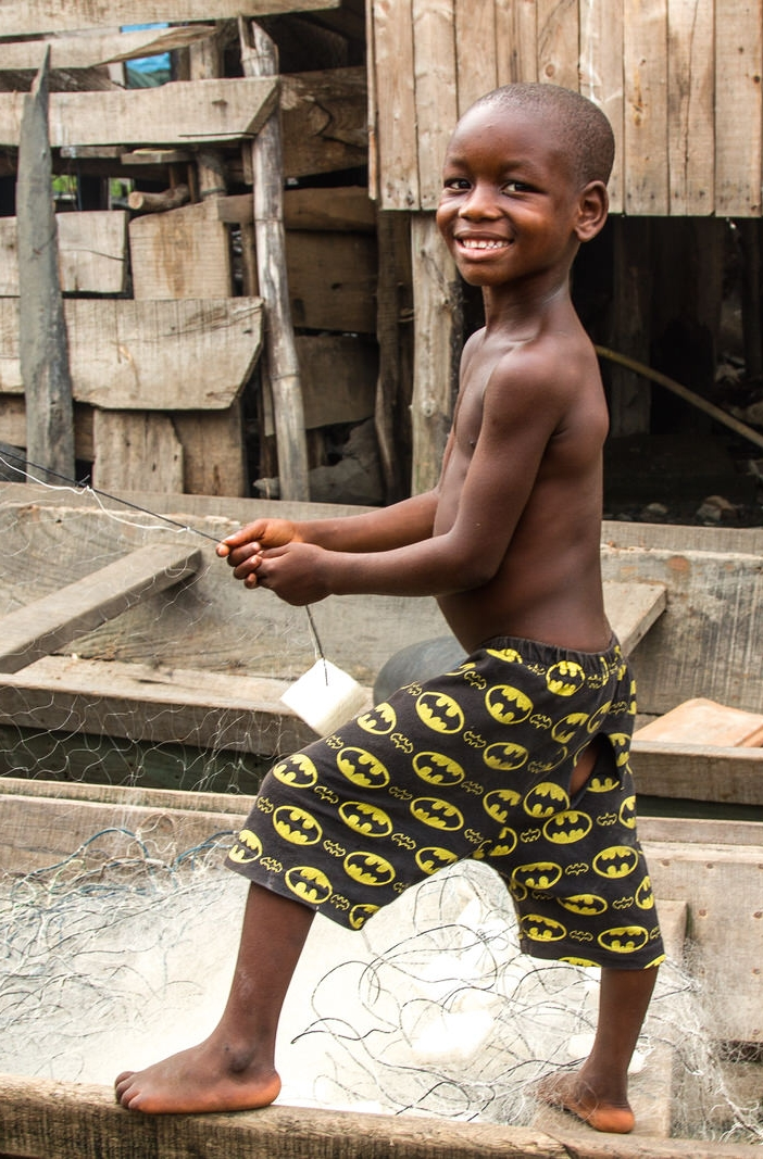 Along with fishing, sand dredging and timber are other major sources of livelihood - this child works on fixing his net.